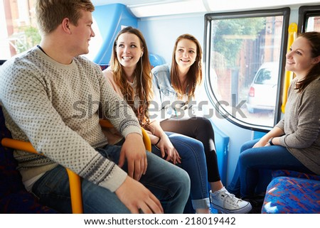 Group Of Young People On Bus Journey Together - stock photo