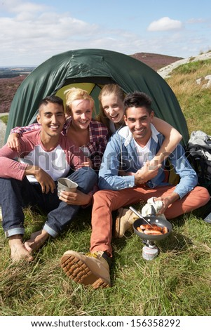 Group Of Young People On Camping Trip In Countryside - stock photo