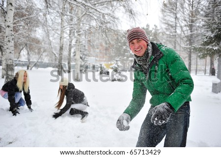 Group of young people playing outdoor snowballs in winter forest - stock photo