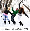 Group of young people playing with snow together in winter park - stock photo