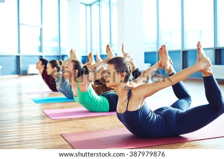 Group of young people relaxing and practicing in yoga - stock photo