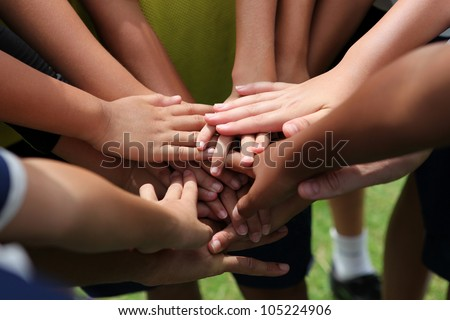 group of young people's hands - stock photo