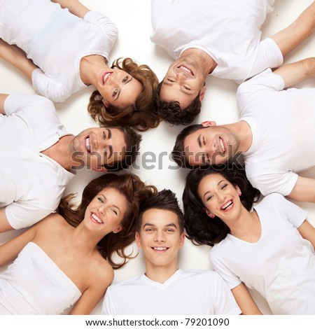 group of young people smiling in circle - stock photo