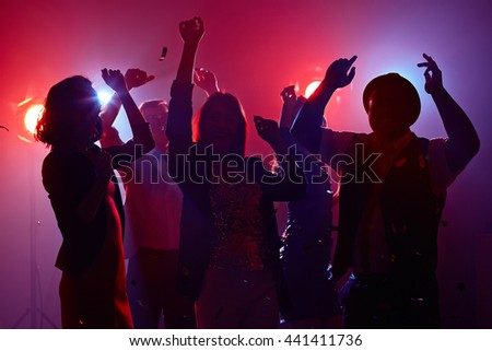 Group of young people spending time at nightclub - stock photo