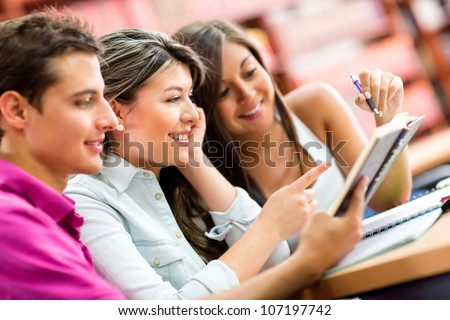 Group of young people studying with a book - stock photo