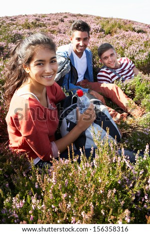 Group Of Young People Taking Break On Hike - stock photo