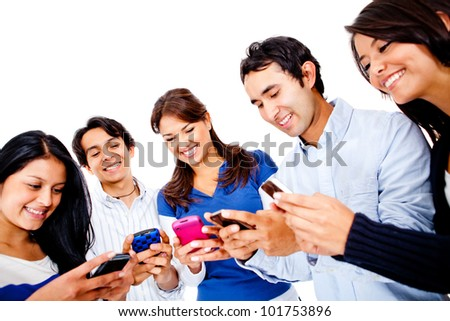 Group of young people texting on their cell phones - isolated over white - stock photo