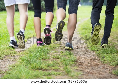 Group of young people training in the park - stock photo