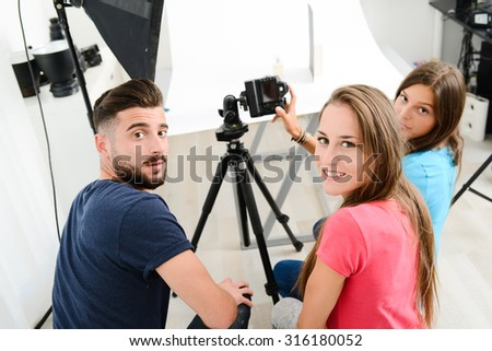 group of young photographer student on photography shooting workshop course indoor in a photo studio - stock photo