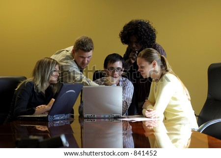 Group of young professionals in a meeting - stock photo