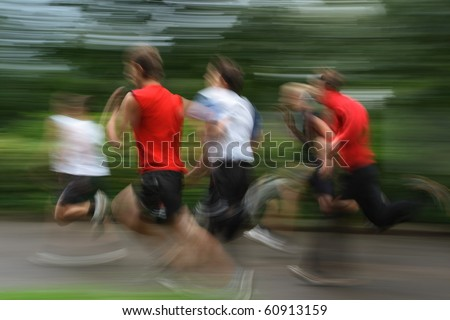 Group of young runners in moving. shooting with long exposure for blur effect.unrecognizable faces - stock photo