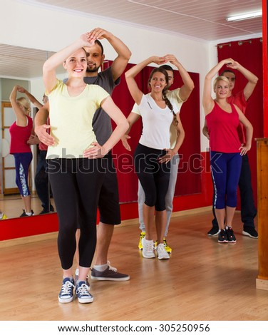Group of young spanish people dancing salsa in studio - stock photo
