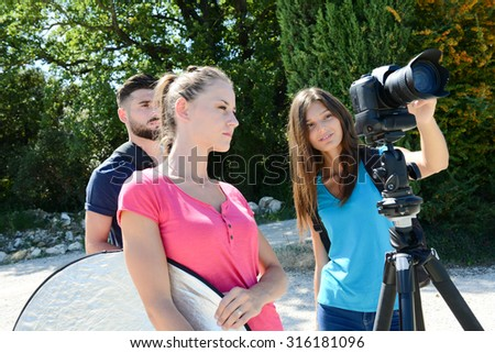 group of young student photographer taking pictures on photography shooting workshop course outdoor - stock photo