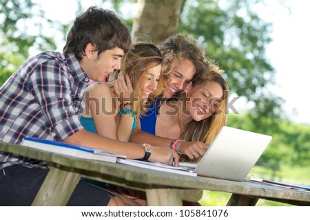 Group of young student using laptop outdoor,Italy - stock photo