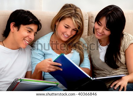 Group of young students smiling with notebooks