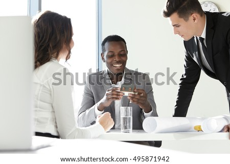 Three businesspeople sitting restaurant table discussing for Most successful architectural firms