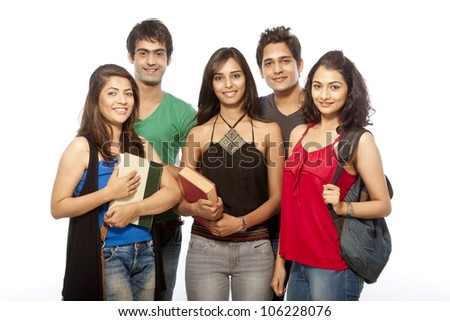 group of young teenager students standing and smiling with books and bags over white background