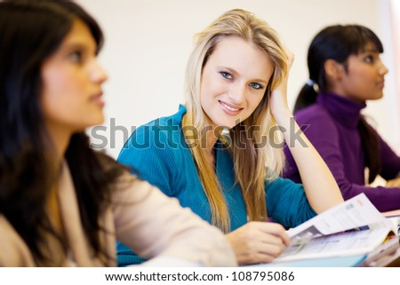 group of young university students in classroom - stock photo