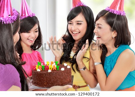 group of young woman celebrating her friend birthday - stock photo