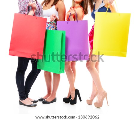 group of young woman with colored shopping sale bags over white