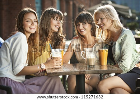 Group of young women drinking coffee - stock photo