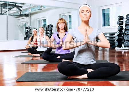 Group of young women in the gym centre. Yoga. - stock photo