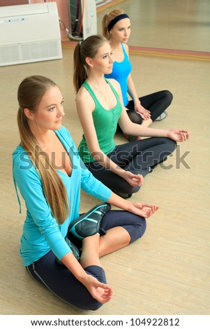 Group of young women in the gym centre. Yoga class. - stock photo