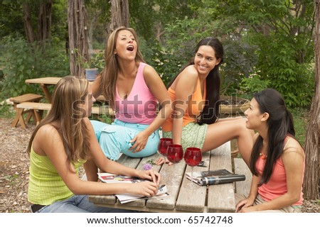 Group of young women talking outdoors - stock photo