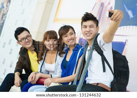 Group of youngsters making photo of themselves - stock photo