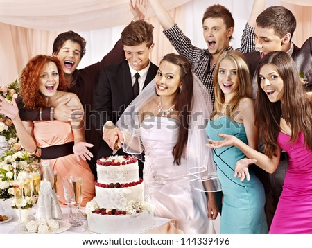 Group people at wedding table cut cake. - stock photo