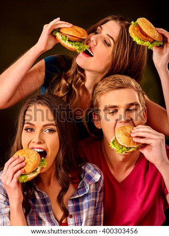 Group people eats with relish hamburgers . Fast food concept.  - stock photo
