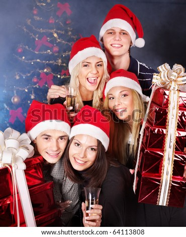 Group  people in santa hat holding stack gift box at nightclub. - stock photo