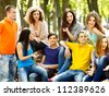 Group people on bench . Summer outdoors. - stock photo