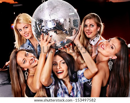 Group people on disco in night club. Lighting effects. - stock photo