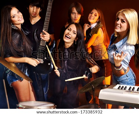 Group people playing  guitar in night club.