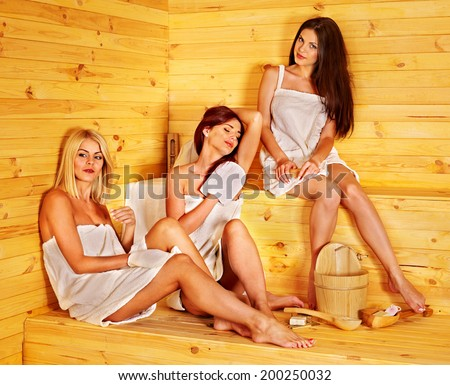 Group people relaxing in sauna. - stock photo