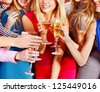 Group people with  champagne dancing at party. - stock photo
