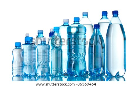 Group plastic bottles of water isolated on white - stock photo