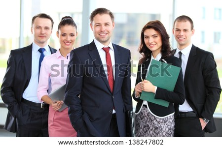 Group portrait of a professional business team looking confidently at camera - stock photo