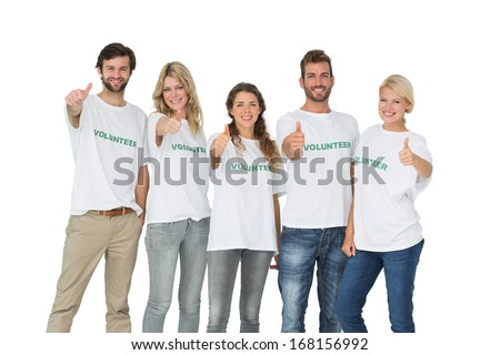 Group portrait of happy volunteers gesturing thumbs up over white background - stock photo