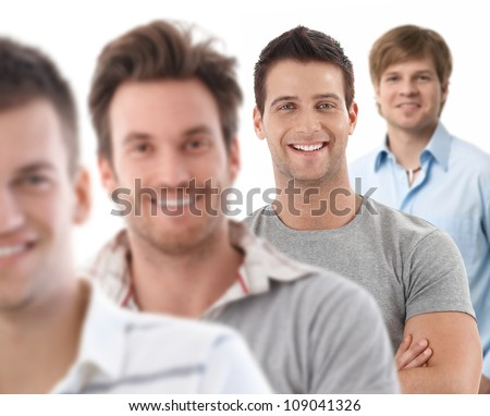 Group portrait of happy young men, looking at camera, smiling. - stock photo