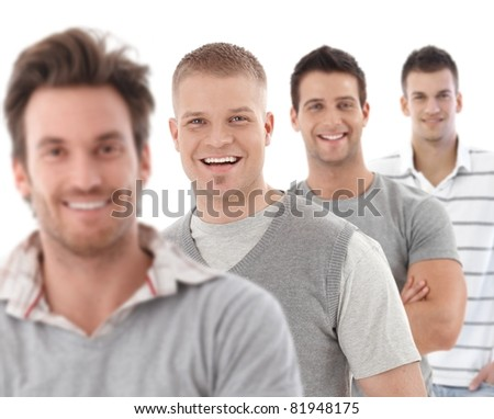 Group portrait of happy young men, looking at camera, smiling.? - stock photo