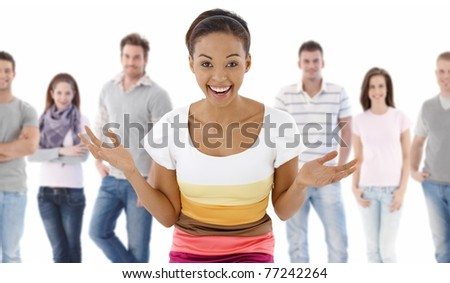 Group portrait of happy young people together, looking at camera, smiling. Young woman at front.? - stock photo