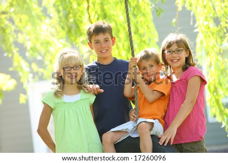 Group portrait of kids outdoors - stock photo