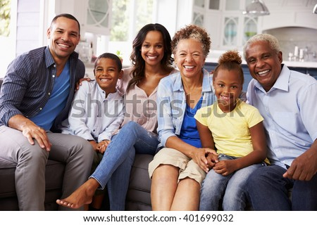 Group portrait of multi generation black family at home - stock photo