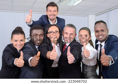 Group portrait of multiethnic business people smiling in office - stock photo