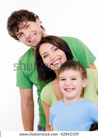 Group portrait of the young happy smiling family looking at camera - stock photo