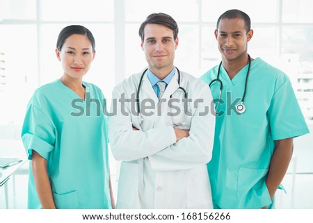 Group portrait of three doctors standing together at the hospital