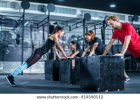Group pushups. Fitness Training in the gym. Group classes in the gym. Group fitness. - stock photo
