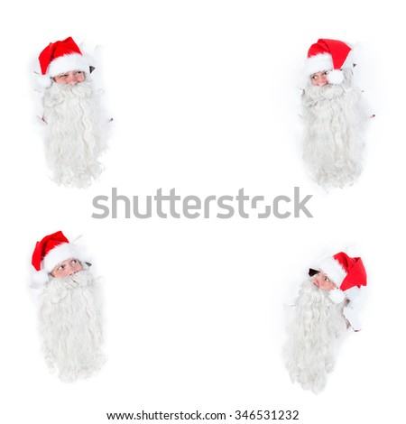 Group Santa Claus looking through holes in a white wall